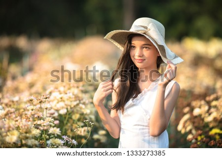 Beautiful girl and flowers field. #1333273385