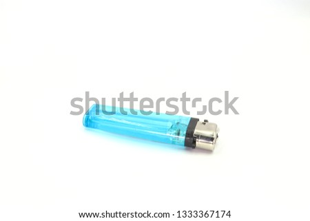 Blue plastic gas lighter. Gas lighter isolated on white background. Closeup shot, top view #1333367174