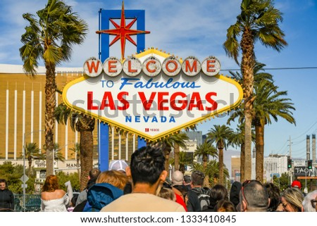 "LAS VEGAS, NV, USA - FEBRUARY 2019: People queuing to have their picture taken in front of the famous ""Welcome to Las Vegas"" sign. The sign is at the southern end of Las Vegas Boulevard. . #1333410845"