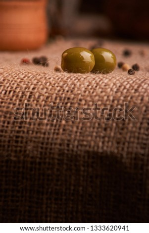 olive is on the table in background of bread, baguette and cheese. Selective focus #1333620941