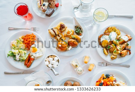 Breakfast Buffet Concept, Breakfast Time in Luxury Hotel, Brunch with Family in Restaurant, Top View of the Table with Plates of Food for Breakfast - Image #1333626233