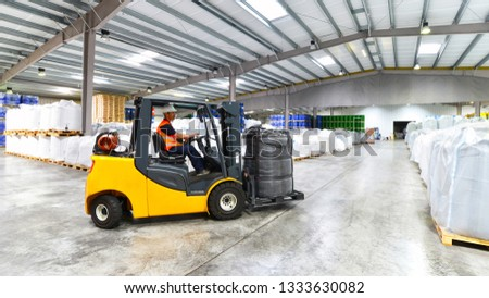 forklift trucks transported in a warehouse - storage of goods in a forwarding agency  #1333630082