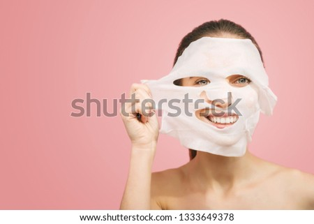 Beauty concept, head and shoulders of girl removing mask from face, face pack #1333649378