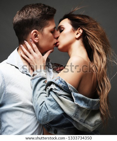 Kiss. Sexy couple in underwear. Studio shot. Young and Beauty. #1333734350