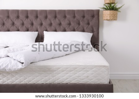 Comfortable bed with new mattress in room. Healthy sleep #1333930100