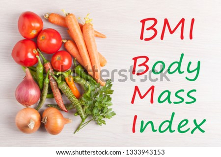 Group vegetables on wooden surface with text Body Mass Index (BMI). Concept sport, diet, fitness, healthy eating. #1333943153