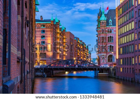 Speicherstadt UNESCO Site in Hamburg at blue hour in the evening #1333948481