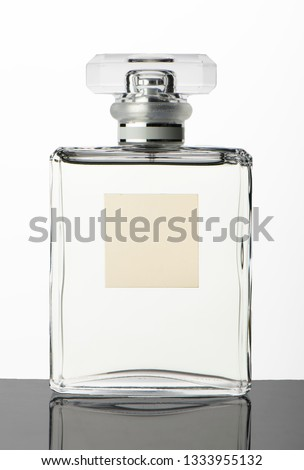 Studio shot transparent glass perfume bottle