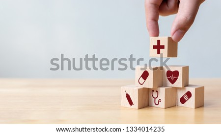 Businessman hand arranging wood block stacking with icon healthcare medical, Insurance for your health concept #1334014235