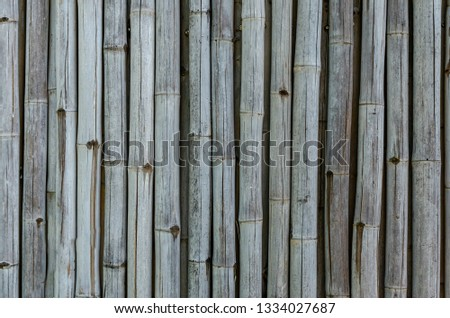 Old bamboo fence background #1334027687