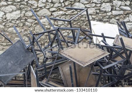 Old tables on a pile under natural lights #133410110