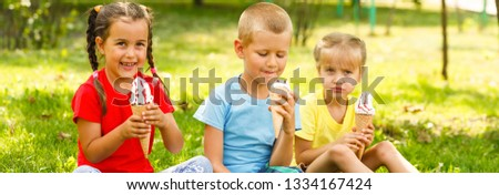 funny children group kidding with ice cream on party #1334167424