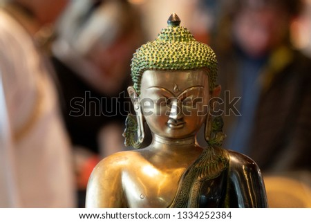 Japanese Buddah statue isolated close up detail #1334252384