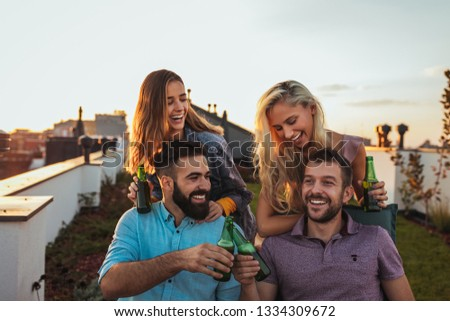 Group of friends hanging out and drinking beer #1334309672