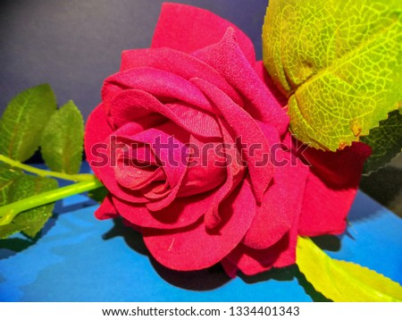 Artificial Red Rose on the table #1334401343