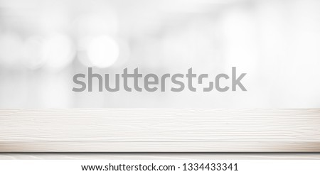 White wood table, tabletop, desk over blur store with white bokeh light background, Empty wood table, shelf, counter, desk for retail shop product display background, banner, mockup, template #1334433341