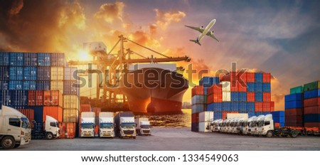 Logistics and transportation of Container Cargo ship and Cargo plane with working crane bridge in shipyard at sunrise, logistic import export and transport industry background #1334549063