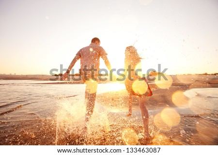 happy couple running on the beach #133463087
