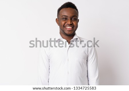 Portrait of happy young African businessman smiling #1334725583