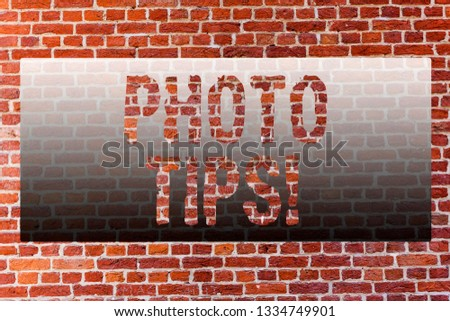 Word writing text Photo Tips. Business concept for Suggestions to take good pictures Advices for great photography Brick Wall art like Graffiti motivational call written on the wall.