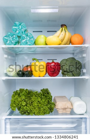 Open fridge full of fresh fruits and vegetables, healthy food background, organic nutrition, health care, dieting concept #1334806241