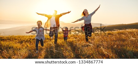 Happy family: mother, father, children son and  daughter on nature  on sunset #1334867774