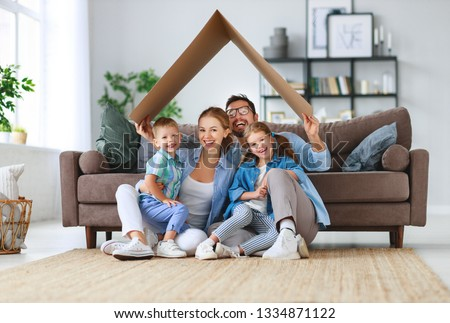 concept of housing and relocation. happy family mother father and kids with roof at a  home  #1334871122