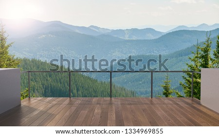 Balcony view of  mountains. Landscape. Sunny Day. Terrace with a beautiful view. Background with beautiful landscape. Royalty-Free Stock Photo #1334969855