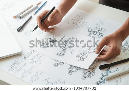 Animator designer Development designing drawing sketching development creating graphic pose characters sci-fi robot Cartoon illustration animation video game film production , animation design studio. #1334987702