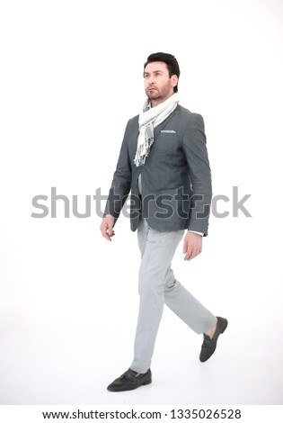 side view.modern business man goes forward #1335026528