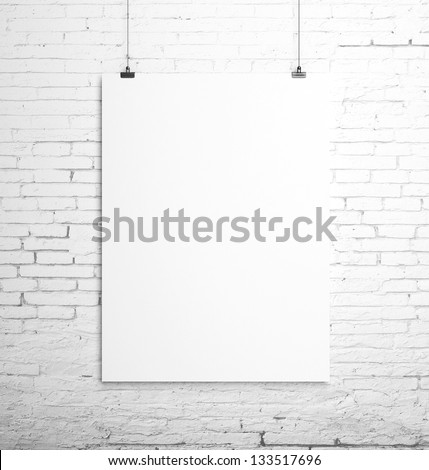 poster hanging on a rope and brick wall
