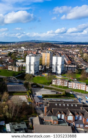 High rise tower blocks, flats built in the city of Stoke on Trent to accommodate the increasing population, housing crisis and over crowding, immigration housing in the city centre #1335233888