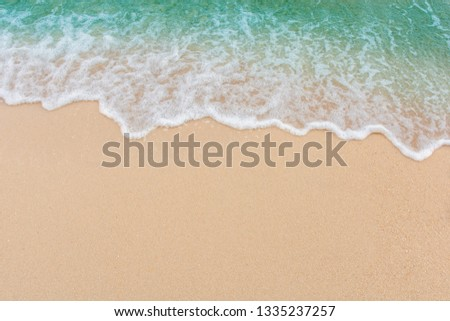 Soft wave of sea on empty sandy beach Background with copy space #1335237257