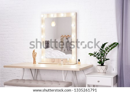 Dressing room interior with makeup mirror and table