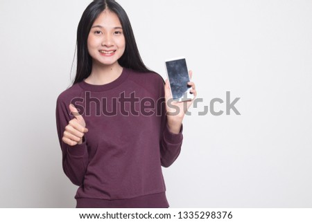 Young Asian woman show thumb up  with mobile phone on white background #1335298376