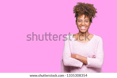 Beautiful young african american woman wearing glasses over isolated background happy face smiling with crossed arms looking at the camera. Positive person. #1335308354