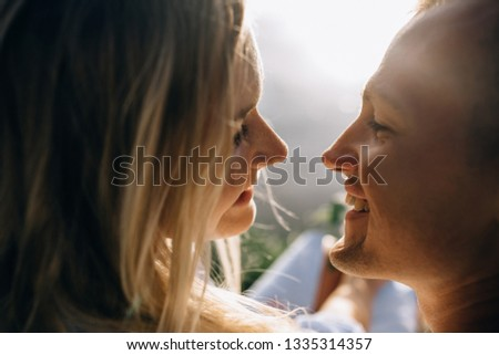 Close up teenager couple in love Kissing in the Bright Spring Day. Outdoor happy couple in love posing. Young boy and girl having fun outdoor #1335314357