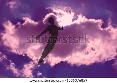 The man is flying in dreams through the cloudy night sky. The opened  arms. Freedom and dreaming concept Royalty-Free Stock Photo #1335376859