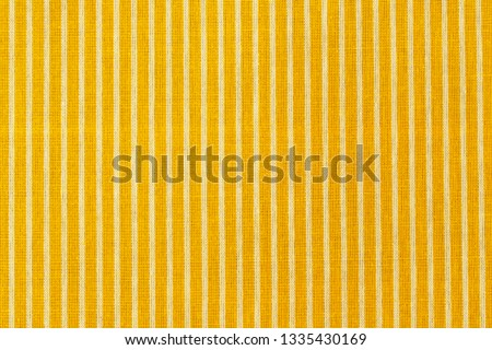Striped yellow white fabric texture. Living yellow linen fashion. Linen cloth surface as Easter Yellow cloth background.  Royalty-Free Stock Photo #1335430169