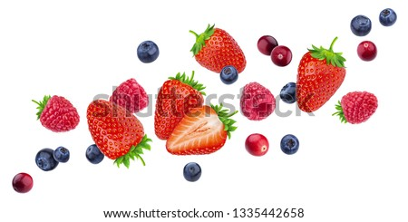 Flying berries isolated on white background with clipping path, different falling wild berry fruits mix, collection #1335442658