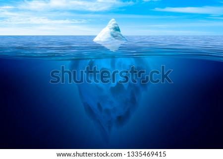 Tip of the iceberg. Underwater iceberg floating in ocean. #1335469415