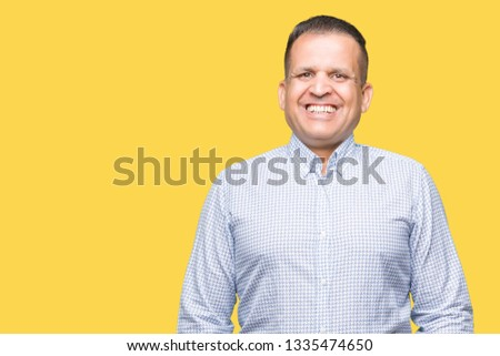 Middle age arab business man over isolated background with a happy and cool smile on face. Lucky person. #1335474650