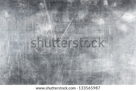 Grunge metal plate texture with screws, background