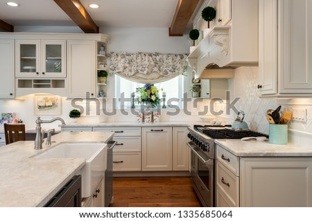 San Diego, CA / USA - November 16, 2018: Inside contemporary kitchen design remodel with two sinks and wood beams #1335685064