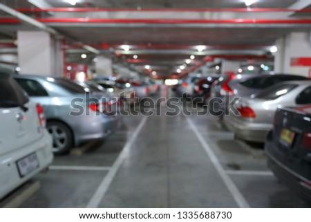 underground of car park in business building, blur image background #1335688730