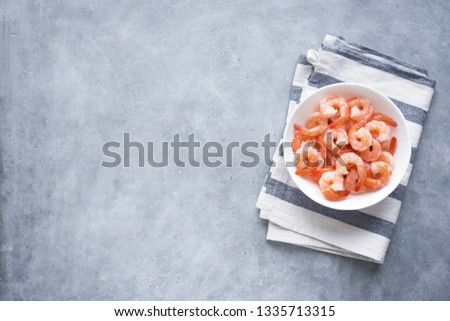 Shrimps, Prawns in bowl, top view, copy space. Fresh seafood ingredient - shrimp tails ready for cooking. Boiled prawns. #1335713315