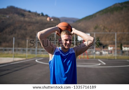 Portrait of young basketball player #1335716189