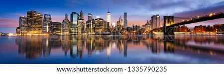 New York City - beautiful sunrise over manhattan with manhattan and brooklyn bridge USA Royalty-Free Stock Photo #1335790235