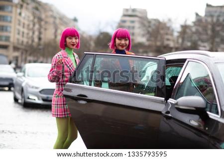 Paris, France - March 04 2019: Paris Fashion Week Street Style  Fall/Winter 2019/2020 Aya Suzuki and Ami Suzuki - Twins Amiaya outside Agnès B #1335793595