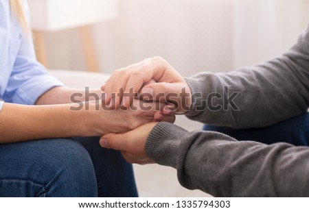Compassion and concern concept. Psychiatrist supporting his patient hands during therapy #1335794303